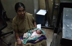 Woman pc breast feeds a abandoned baby