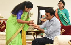 TRS MP kavitha gifts helmet to minister ktr