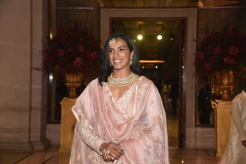 Badminton star and Olympian PV Sindhu arrives for the reception of Deepika and Ranveer. She is seen in a pink outfit.