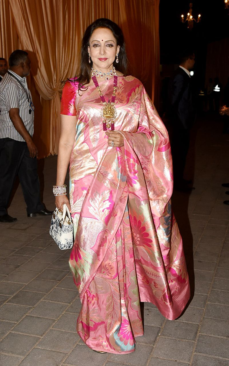 Hema Malini is decked up pretty in silk and precious stones for the Isha Ambani, Anand Piramal wedding reception.