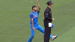 Bhuvneshwar Kumar bowling behind the stumps