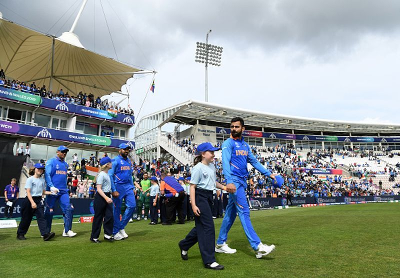 Virat Kohli leads the Indian team on to the field