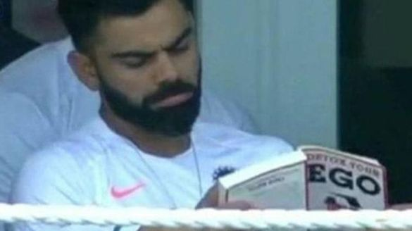 team india captain Virat Kohli reading Detox Your Ego book during the 1st test match