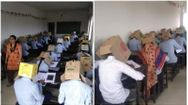 students asked to wear card board box on head to stop copying during exams