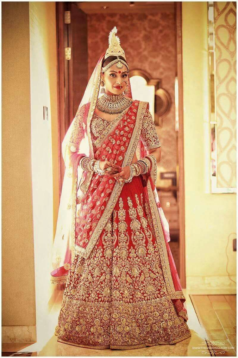 To exchange vows with husband, actor Kunal Khemu, Soha Ali Khan chose a lehenga from the designer's Opium collection. The orange and gold outfit was paired up with heavy jewellery and a passa.