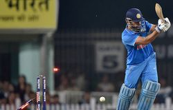 The bails fly off the wicket resulting in the dismissal of India's Mahendra Singh Dhoni, bowled out by New Zealand's James Neesham during the fourth one-day international cricket match in Ranchi on Wednesday.